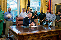 United States President Donald J. Trump waits for the press pool to settle before signing the National Manufacturing Day Proclamation in the Oval Office of the White House in Washington, DC on Friday, October 6, 2017.<br /> CAP/MPI/CNP/RS<br /> &copy;RS/CNP/MPI/Capital Pictures