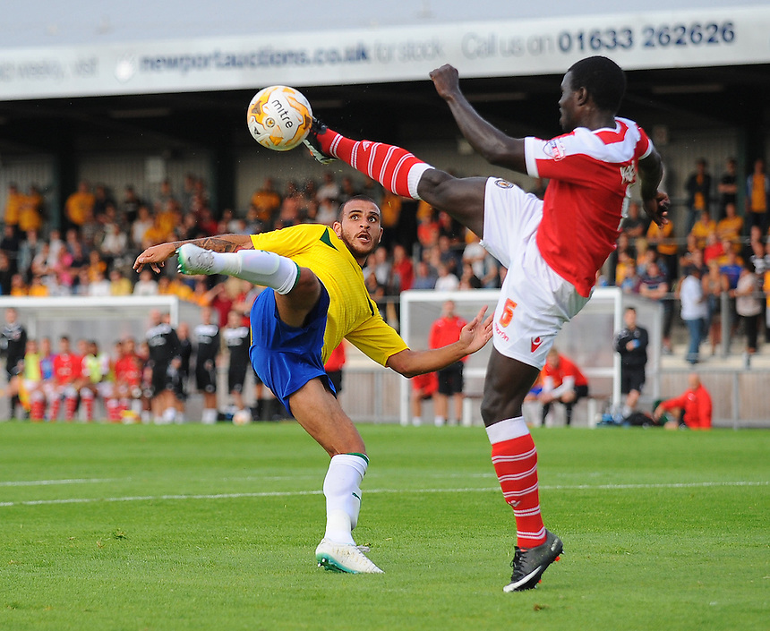Coventry City's Marcus Tudgay vies for possession with Newport County's Ismail Yakubu<br /> <br /> Photographer Kevin Barnes/CameraSport<br /> <br /> Football Friendly - Newport County AFC v Coventry City - Tuesday 29th July 2014 - Newport Stadium - Newport<br /> <br /> &copy; CameraSport - 43 Linden Ave. Countesthorpe. Leicester. England. LE8 5PG - Tel: +44 (0) 116 277 4147 - admin@camerasport.com - www.camerasport.com