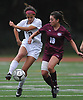 Cailey Welch #10 of North Shore, left, and Gracie McManus #10 of Garden City battle for possession during the second half of a Nassau County varsity girls soccer match against Garden City at North Shore High School on Monday, Sept. 18, 2017. McManus scored a goal on a penalty kick in the first half while Welch tied the game 1-1 eight minutes into the second half. North Shore went on to win by a score of 2-1.