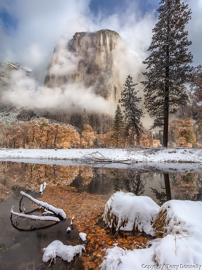Yosemite National Park, California: El Capitan with calm reflections along the Merced River after a snowfall, late fall.