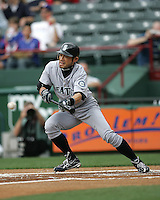 Seattle Mariners OF Ichiro Suzuki bunts against the Texas Rangers on May 14th, 2008 at Texas Rangers Ball Park. Photo by Andrew Woolley / Four Seam Images.