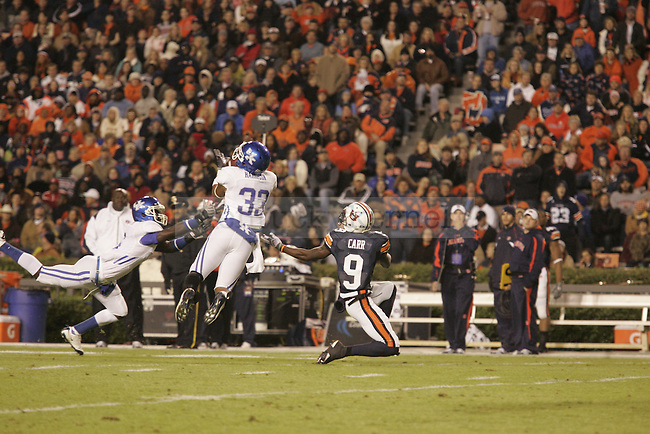 UK strong safety Calvin Harrison intercepts the ball in the first half of the game against Auburn at the Jordan-Hare Stadium Saturday..Photo by Zach Brake | Staff