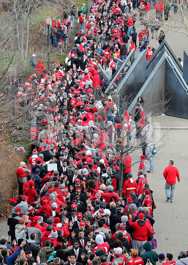 The Ohio State Buckeyes make their way into the stadium surrounded by fans before the college football game between the Ohio State Buckeyes and the Michigan Wolverines at Ohio Stadium in Columbus, Saturday morning, November 29, 2014.  (The Columbus Dispatch / Eamon Queeney)