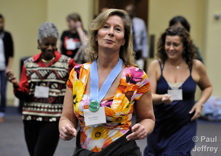 Susan Erickson, a member of United Methodist Women in the Pacific Northwest Annual Conference, participates in a workshop on salsa dancing at the 2010 Assembly of United Methodist Women in St. Louis, Missouri, Missouri.