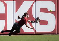 NWA Democrat-Gazette/CHARLIE KAIJO An Arkansas Razorbacks outfielder dives for a catch during a softball match, Sunday, October 28, 2018 at Bogle Park, University of Arkansas in Fayetteville.<br />