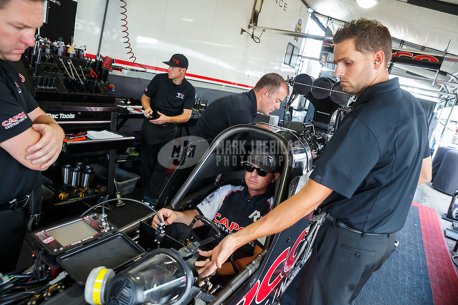 Sep 3, 2016; Clermont, IN, USA; Crew members for NHRA top fuel driver Steve Torrence during qualifying for the US Nationals at Lucas Oil Raceway. Mandatory Credit: Mark J. Rebilas-USA TODAY Sports