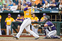LSU Tigers catcher Kade Scivicque (22) follows through on his swing against the TCU Horned Frogs in Game 10 of the NCAA College World Series on June 18, 2015 at TD Ameritrade Park in Omaha, Nebraska. TCU defeated the Tigers 8-4, eliminating LSU from the tournament. (Andrew Woolley/Four Seam Images)