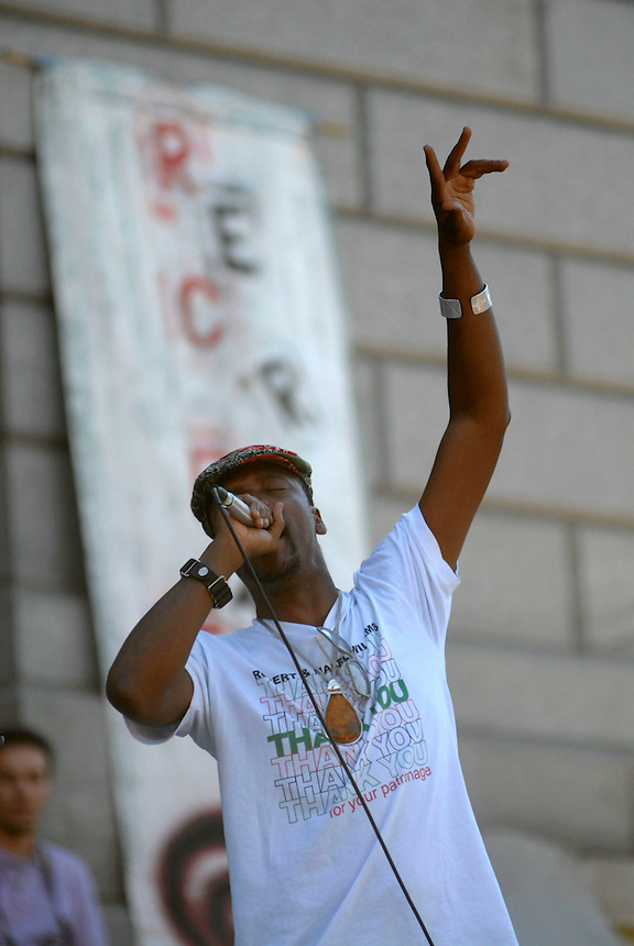 24 Aug 08: Rapper M-1 of the hip hop duo Dead Prez performs on the steps of the Colorado state capitol building. On the day before the Democratic National Convention is scheduled to begin about 1,500 people participated in the ReCreate 68 rally, which included a march from the Colorado state capitol building to the Pepsi Center.