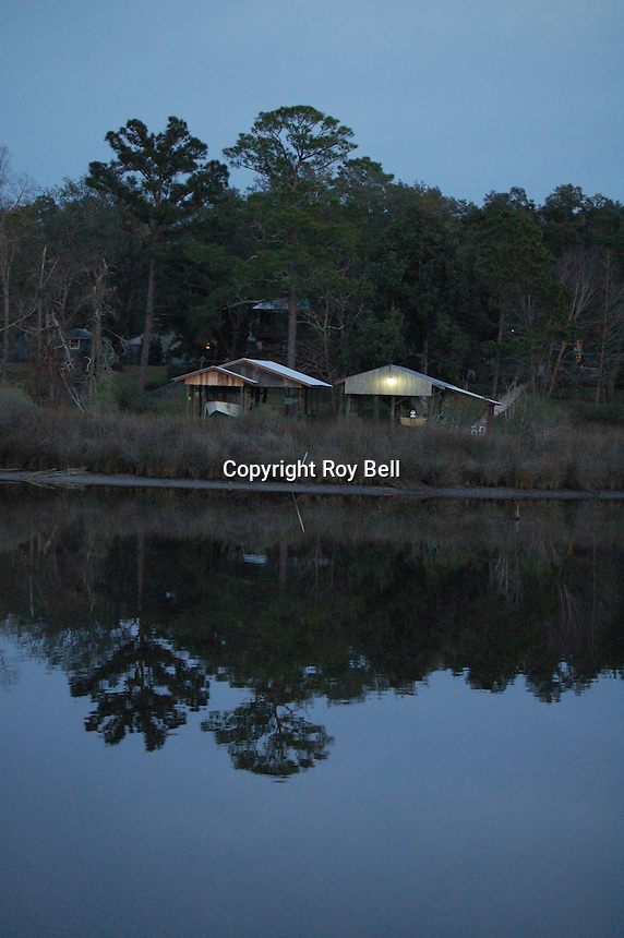 Boat house on Miflin Creek near Foley Alabama, reflecting on the water at dusk. Spring 2008