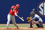 09 June 2012: NC State's Tarran Senay (32) hits the ball in front of Florida catcher Mike Zunino (right). The University of Florida Gators defeated the North Carolina State University Wolfpack 7-1 at Alfred A. McKethan Stadum in Gainesville, Florida in Game 1 of their NCAA College Baseball Super Regional series.