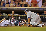 28 September 2012: Detroit Tigers third baseman Miguel Cabrera looks at catcher Joe Mauer after being tagged out at the plate during a game against the Minnesota Twins at Target Field in Minneapolis, MN. The Twins defeated the Tigers 4-2 in the first game of their 3-game series. Mandatory Credit: Ed Wolfstein Photo