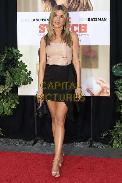 JENNIFER ANISTON.arrives to the Los Angeles Premiere of Miramax's 'The Switch,' at the Arclight Hollywood Cinema, Hollywood, CA, USA, August 16th 2010.full length dress black skirt strappy sandals open toe clutch bag strapless beige nude .CAP/CEL .©CelPh/Capital Pictures