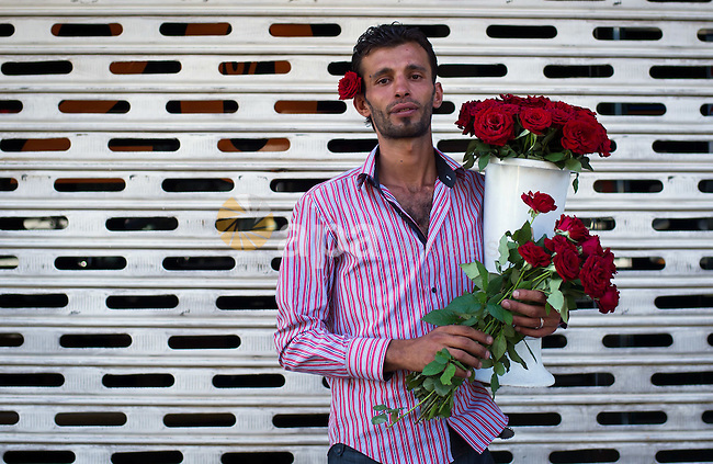 Aug. 2, 2012 - Damascus, Syria - A Syrian flower seller poses on a street. (Credit Image: © Qin Haishi/Xinhua/ZUMAPRESS.com)