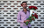 Aug. 2, 2012 - Damascus, Syria - A Syrian flower seller poses on a street. (Credit Image: © Qin Haishi/Xinhua/ZUMAPRESS.com)