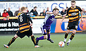 Annan's Jack Steele (6) is brought down by Alloa's Ryan McCord (8) as team mate Graeme Holmes (10) looks on.