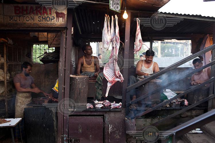 A butcher selling mutton in Dharavi slum.