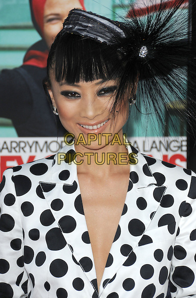 """BAI LING.The HBO Screening of """"Grey Gardens"""" held at The Grauman's Chinese Theatre in Hollywood, California, USA..April 16th, 2009 .headshot portrait black white polka dot jacket hair piece feathers hat .CAP/DVS.©Debbie VanStory/Capital Pictures."""