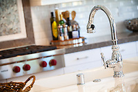 White Kitchen Cabinets and Chrome Faucet