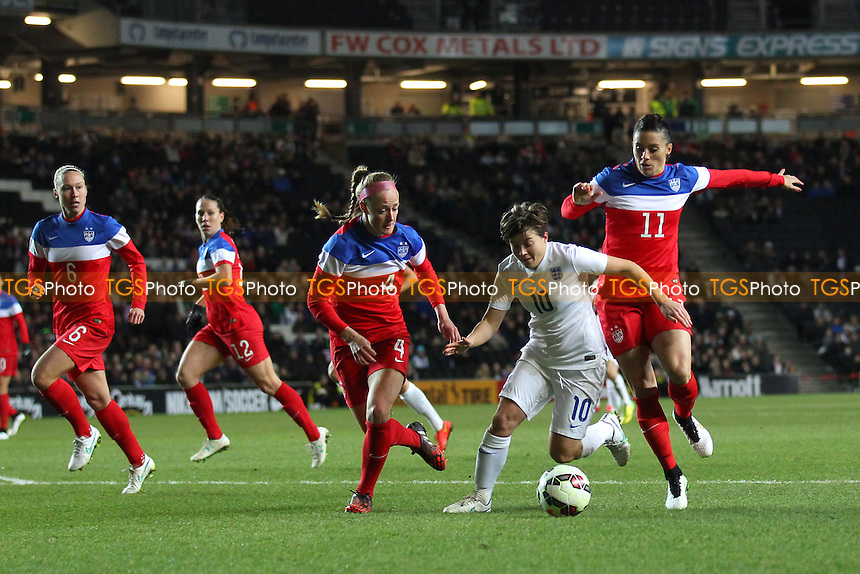 Francesca Kirby of England is crowded out by the USA defence - England Women vs USA Women - International Football Friendly Match at Stadium MK, Milton Keynes Dons FC - 13/02/15 - MANDATORY CREDIT: Gavin Ellis/TGSPHOTO - Self billing applies where appropriate - contact@tgsphoto.co.uk - NO UNPAID USE