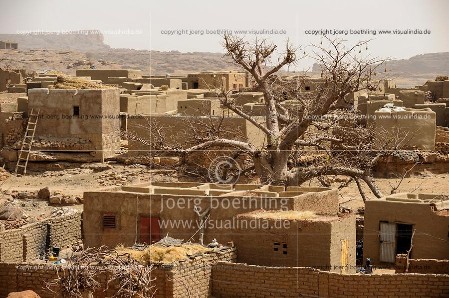 MALI,  Bandiagara, Dogonland, habitat of the ethnic group Dogon, Dogon village with clay houses and Baobab tree