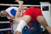 Moscow, Russia, 05/06/2010..The referee watches Ivan Kosov and Achmed Mysaev struggle during a Sambo bout, part of the new Fight Nights boxing tournament.