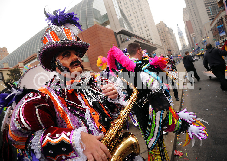 PHILADELPHIA - JANUARY 1:  Anthony Marchese, of Downingtown, Pennsylvania and a member of the South Philadelphia String Band takes a break after performing during the 2011 Mummers Parade in Philadelphia, Pennsylvania. Thousands of people enjoyed the warmer weather and watched the parade, which has been around for over 100 years. (Photo by William Thomas Cain/Getty Images)