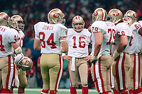 NEW ORLEANS, LA - Quarterback Joe Montana of the San Francisco 49ers in the huddle with his teammates during Super Bowl XXIV against the Denver Broncos at the Superdome in New Orleans, Louisiana in January of 1990. Photo by Brad Mangin.