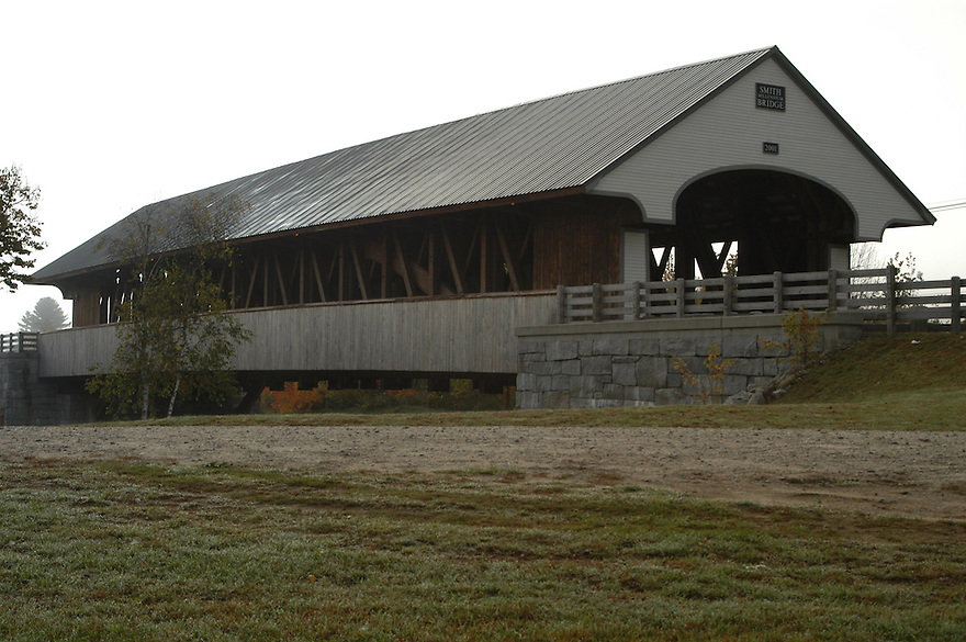 The newly rebuilt Smith Millenium Covered Bridge spans the Baker River in Plymouth New Hampshire.