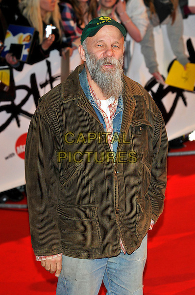 SEASICK STEVE .Arrivals - 2009 Brit Awards, Earls Court, London, England, February 18th 2009..brits half length beard green jacket brown hat cap scruffy facial hair .CAP/PL.©Phil Loftus/Capital Pictures