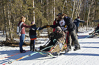 Rick Casillo and team run past spectators on the bike/ski trail during the Anchorage ceremonial start during the 2014 Iditarod race.<br /> Photo by Britt Coon/IditarodPhotos.com