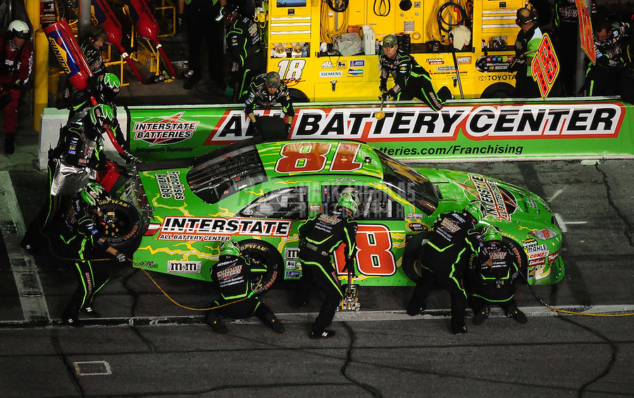 Jul. 3, 2010; Daytona Beach, FL, USA; NASCAR Sprint Cup Series driver Kyle Busch (18) pits during the Coke Zero 400 at Daytona International Speedway. Mandatory Credit: Mark J. Rebilas-