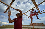 Leonardo Cantillo and his son Fabian erect a shelter at Tarau-Paru, a Pemon indigenous village just inside Brazil. Cantillo and his family are refugees, having fled from Venezuela early in 2019 after new outbreaks of violence between the Venezuelan military and Pemon villagers.