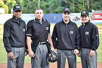 Umpiring crew (L-R) Edwin Moscoso, Jonathan Parra, Grant Conrad and Chris Scott before game 3 of the South Atlantic League Championship Series between the Asheville Tourists and the Hickory Crawdads on September 17, 2015 in Asheville, North Carolina. The Crawdads defeated the Tourists 5-1 to win the championship. (Tony Farlow/Four Seam Images)