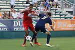 09 July 2014: Carolina's Kupono Low (3) knocks Dallas' Tesho Akindele (left) off of the ball. The Carolina RailHawks of the North American Soccer League played FC Dallas of Major League Soccer at WakeMed Stadium in Cary, North Carolina in the quarterfinals of the 2014 Lamar Hunt U.S. Open Cup soccer tournament. FC Dallas won the game 5-2.