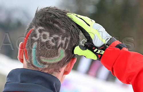 07.03.2014. Sochi, Russia.  Martin Fleig of Germany presents his paralympic-haircut during a free training session of Nordic Skiing - Sitting at Laura Cross-country Ski & Biathlon Center at the Sochi 2014 Paralympic Winter Games, Krasnaya Polyana, Russia, 07 March 2014.