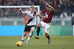 Simone Verdi of Torino FC challenges Jerdy Schouten of Bologna during the Serie A match at Stadio Grande Torino, Turin. Picture date: 12th January 2020. Picture credit should read: Jonathan Moscrop/Sportimage