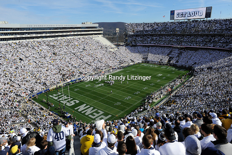 """21 November 2015:  Penn State fans start to cheer as the scoreboard says """"Get Loud""""  during the whole stadium white out or white house in Beaver Stadium. The Penn State Nittany Lions vs. the Michigan Wolverines at Beaver Stadium in State College, PA. (Photo by Randy Litzinger/Icon Sportswire)"""