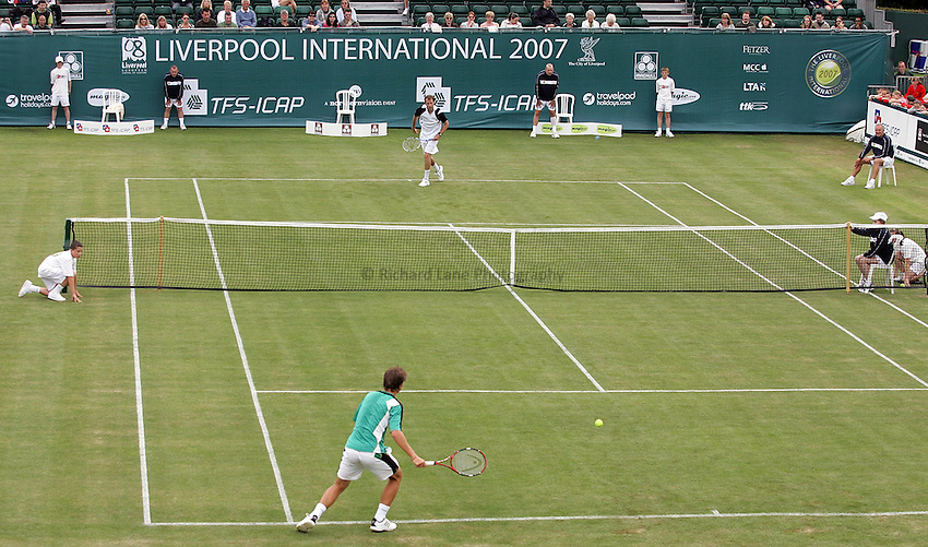 Photo: Paul Thomas..The Liverpool International 2007. 12/06/2007...Greg Rusedski (Top) of the UK serves to Chris Llewellyn (Green).