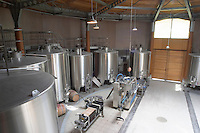 In the circular winery vat hall with stainless steel fermentation tanks, a filter and a bottling line Chateau Bouscaut Cru Classe Cadaujac Graves Pessac Leognan Bordeaux Gironde Aquitaine France