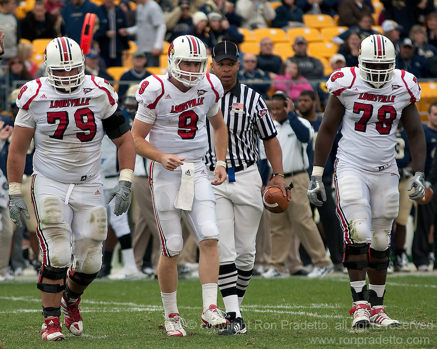 Louisville quarterback Adam Froman hobbles off the field in the fourth quarter. Also shown are linemen Mark Wetterer (79) and Byron Stingily (78).  The Pitt Panthers defeated the Louisville Cardinals 20-3 at Heinz Field, Pittsburgh Pennsylvania on October 30, 2010.