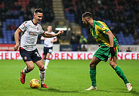 Bolton Wanderers' Pawel Olkowski competing with West Bromwich Albion's Kieran Gibbs<br /> <br /> Photographer Andrew Kearns/CameraSport<br /> <br /> The EFL Sky Bet Championship - Bolton Wanderers v West Bromwich Albion - Monday 21st January 2019 - University of Bolton Stadium - Bolton<br /> <br /> World Copyright © 2019 CameraSport. All rights reserved. 43 Linden Ave. Countesthorpe. Leicester. England. LE8 5PG - Tel: +44 (0) 116 277 4147 - admin@camerasport.com - www.camerasport.com