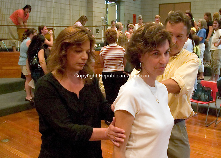 WATERBURY, CT - 29 AUGUST 2005 -082905JS02--Rob Davis, right, a trainer with The Institute of Professional Practice based in Woodbridge, with the help of Linda Bousvert, center, a pre-k teacher at Bucks Hill School, demonstrates to Elaine Sweet, left, a paraprofessional at Bucks Hill School, an escorting technique, during an aggression prevention and management training workshop at East End Middle School in Waterbury on Monday. The program was for teachers and paraprofessional in early childhood program and special education pre-school programs.  --Jim Shannon / Republican-American  -- Rob Davis; The Institute of Professional Practice; Linda Bousvert; Bucks Hill School; Elaine Sweet; East End Middle School; Waterbury are CQ