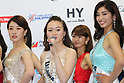 Miss Earth Japan contestants smile at a press preview