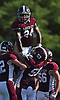 Trevor Yeboah-Kodie #24 of Garden City gets hoisted into the air after breaking loose for a 51-yard rushing touchdown in the third quarter of a Nassau County Conference II varsity football game against Carey at Garden City High School on Saturday, Sept. 29, 2018. Garden City won by a score of 38-14.