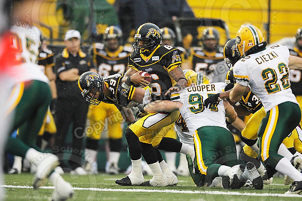 August 8, 2009; Hamilton, ON, CAN; Hamilton Tiger-Cats wide receiver Marquay McDaniel (6) is tackled by Edmonton Eskimos defensive end Justin Cooper (97). CFL football: Edmonton Eskimos vs. Hamilton Tiger-Cats at Ivor Wynne Stadium. The Tiger-Cats defeated the Eskimos 28-21. Mandatory Credit: Ron Scheffler. Copyright (c) 2009 Ron Scheffler.