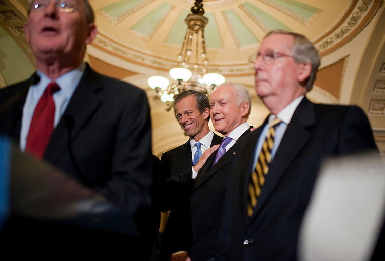 UNITED STATES - OCTOBER 12:  John Thune, R-S.D., left center, shares a laugh with Sen. Orrin Hatch, R-Utah, during a news conference after the senate luncheons.  Senate Republican Conference Chair Lamar Alexander, R-Tenn., left, and Senate Minority Leader Mitch McConnell, R-Ky., also appear.  (Photo By Tom Williams/Roll Call)