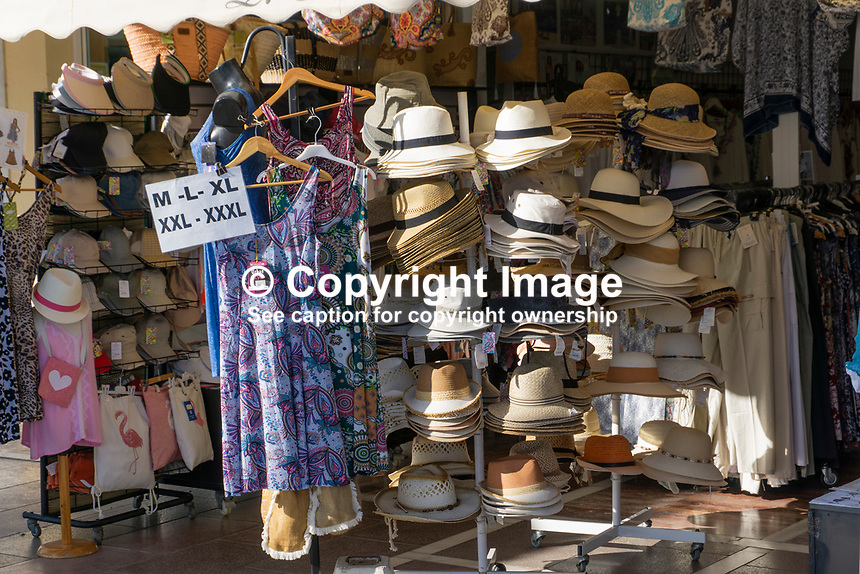 Garments and headgear for an expanding population. Taken seafront Marbella, Malaga Province, Spain, 1 December 2018. 201812018143<br /><br />Copyright Image from Victor Patterson, 54 Dorchester Park, <br />Belfast, UK, BT9 6RJ<br /><br />t1: +44 28 9066 1296 (from Rep of Ireland 048 9066 1296)<br />t2: +44 28 9002 2446 (from Rep of Ireland 048 9002 2446)<br />m: +44 7802 353836<br /><br />victorpattersonbelfast@gmail.com<br /><br />Please see my Terms and Conditions of Use at victorpatterson.com. It is IMPORTANT that you familiarise yourself with them.<br /><br />Images used on the Internet incur an additional cost and must be visibly watermarked i.e. &copy; Victor Patterson within the body of the image and copyright metadata must not be deleted. Images used on the Internet have a size restriction of 4kbs and are chargeable at rates available at victorpatterson.com.<br /><br />This image is available only for the use of the download recipient i.e. television station, newspaper, magazine, book publisher, etc, and must not be passed on to any third party. It is also downloaded on condition that each and every usage is notified within 7 days to victorpattersonbelfast@gmail.com<br /><br />The right of Victor Patterson (or the named photographer) to be identified as the author is asserted in accordance with The Copyright Designs And Patents Act (1988). All moral rights are asserted.
