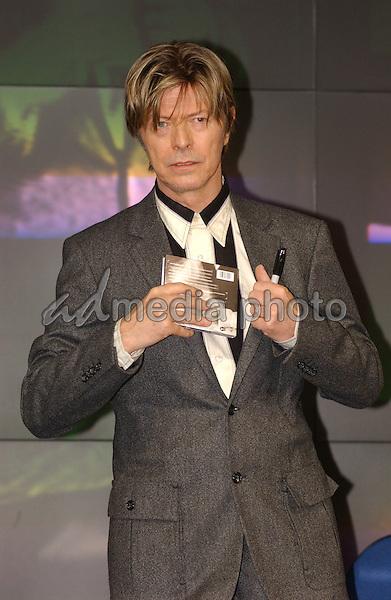 "FILE PHOTO: 9/9/02   DAVID BOWIE   SIGNS COPIES OF HIS ALBUM ""HEATHEN""   AT THE HMV SHOP OXFORD STREET LONDON. Photo Credit: Alpha Press/AdMedia"