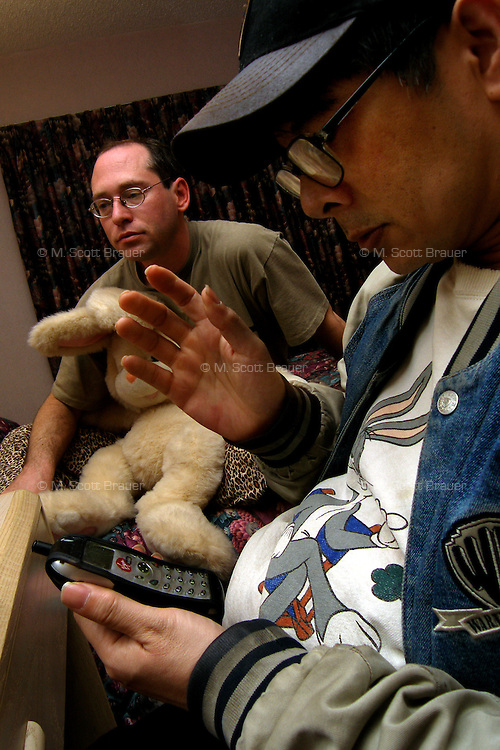 Gary Shultz (left), a.k.a. Foxwell Foxcoon, and Richard J. Concepcion, a.k.a. Rapid T. Rabbit, finish contact other furries before going to bed in a hotel in Ocean City, New Jersey.   Furries are a group of people who identify themselves not as being human but as a walking, talking animal.  For some the lifestyle is complete, animal traits reach into every aspect of life from mundane trips to a grocery store to sexual fantasies.  For others, involvement in the furry fandom is limited to public performances and meet-and-greets.
