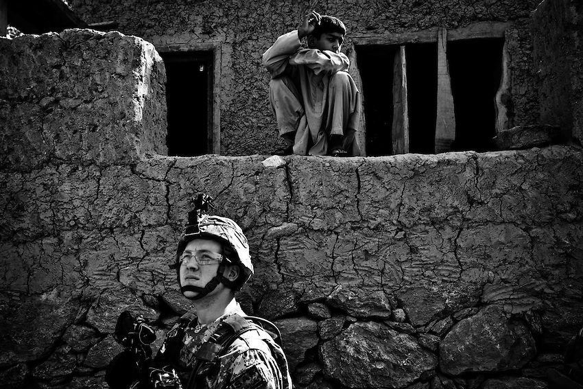 Members of 3rd Platoon, Dagger Company, 2-12th Infantry talk to local villagers about damage caused to houses by ordnance fired into the village of Matin, in the Pesh Valley, Kunar Province, Afghanistan, Sunday, Sept 27, 2009.